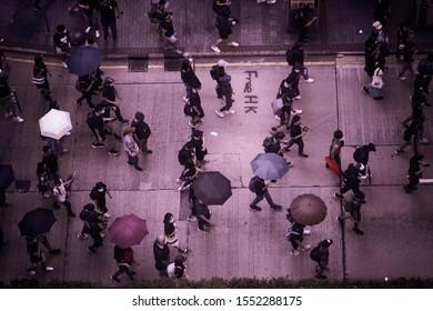 """""""Hong Kong/ China - October 19th 2019: People marching at a protest in Tsim Tsa Tsui ."""""""