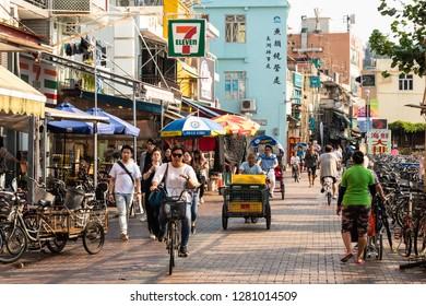 Hong Kong, China - October 8 2018: People walking along the main street of the town on Cheung Chau island, an outlying island in Hong Kong, China