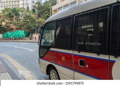 HONG KONG, CHINA - Hong Kong police vehicle on duty on Nathan Road in Kowloon, Hong Kong, China. The Mercedes-Benz Sprinter van is the most commonly seen police vehicles in Hong Kong.November 28,2019.