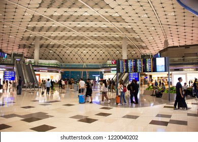 HONG KONG, CHINA - SEPTEMBER 10 : Chinese and foreigner travelers walking in terminal 2 of Hong Kong International Airport or Chek Lap Kok Airport on September 10, 2018 in Hong Kong, Mainland China