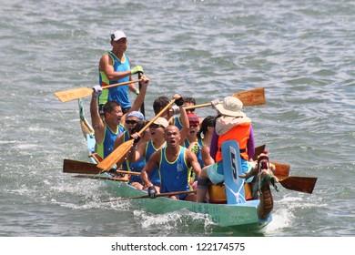 HONG KONG, CHINA - SEPTEMBER 2: Unidentified team competes at the 2012 Dragon Boat Race in Sai Kung bay on September 2, 2012 in Hong Kong, China.