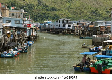 HONG KONG, CHINA - SEPTEMBER 25, 2015: small houses and boats in Tai O fishing village on the western side of Lantau Island, Hong Kong