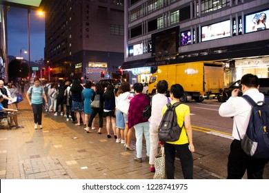 HONG KONG, CHINA - SEPTEMBER 5 : Chinese people standing in queue line for wait bus at station for go home after finish work at Tsim Sha Tsui town in evening on September 5, 2018 in Hong Kong, China