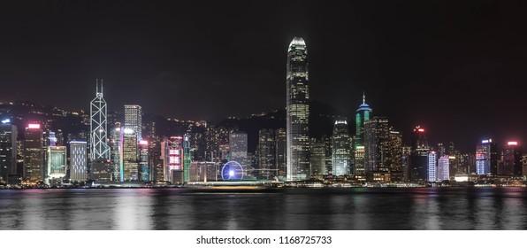 Hong Kong, China-10.06.2017: Night skyline panorama of Hong kong city from across Victoria Harbor.