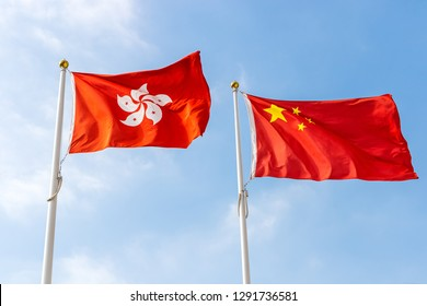Hong Kong and Chinese Flag in Blue Sky