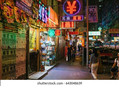 HONG KONG - CIRCA APRIL, 2017: People are walking on the street in Mong Kok at night. Mong Kok is the area that mixed of vintage old town and new shopping shop with colorful neon sign.