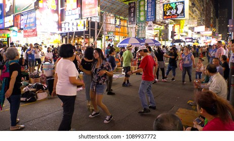 HONG KONG - CIRCA APRIL 2018 : Scenery of PEOPLE DANCING at SAI YEUNG CHOI STREET at MONG KOK area.  Place is famous for shopping and street performance.