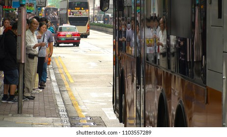HONG KONG - CIRCA APRIL 2018 : Scenery of local people waiting for bus at the bus stop in MONG KOK area.