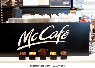 HONG KONG - CIRCA NOVEMBER, 2016: McCafe sign at Hong Kong International Airport. McCafe is a coffee-house-style food and drink chain, owned by McDonald's.