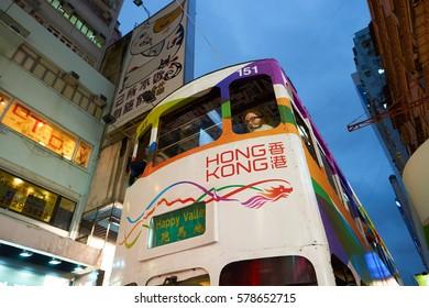 HONG KONG - CIRCA NOVEMBER, 2016: a double decker train in Hong Kong urban landscape at nighttime. Hong Kong  is an autonomous territory on the Pearl River Delta of East Asia.