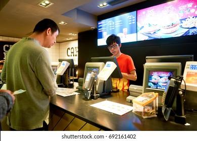 HONG KONG - CIRCA NOVEMBER, 2016: counter service in a McDonald's restaurant in Hong Kong. McDonald's, or simply McD, is an American hamburger and fast food restaurant chain.