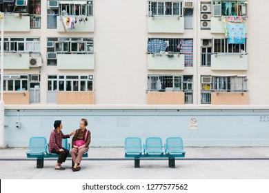HONG KONG - CIRCA NOVEMBER, 2018: People relax at pastel flat Choi Hung Estate.