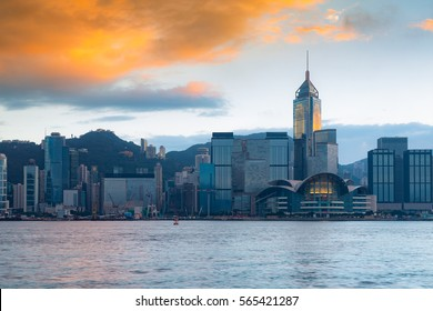Hong Kong city business downtown sea front with sunrise sky background