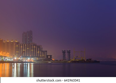 Hong Kong city skyline at pier over Victoria Harbor, Twilight scene