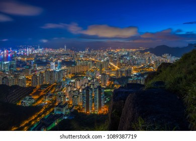 Hong Kong city skyline at sunset and twilight, top view of Kowloon public pier, the cityscape of business and financial district, one of the world's most significant financial centres, Asia-Pacific