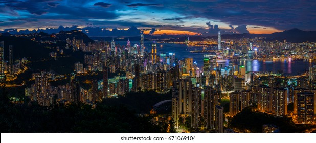 Hong Kong city skyline at sunset and twilight, panorama view from Jardine's Lookout,  Wilson Trail and Hong Kong Trail.