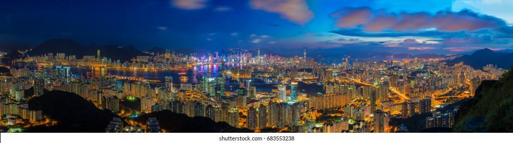 Hong Kong city skyline at sunset and twilight, panorama view Kowloon public pier, the cityscape of business and financial district, one of the world's most significant financial centres, Asia-Pacific