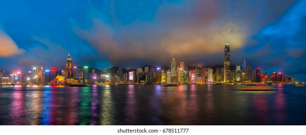 Hong Kong city skyline at twilight, panorama view from Kowloon public pier, the cityscape of business and financial district, one of the world's most significant financial centres, Asia-Pacific