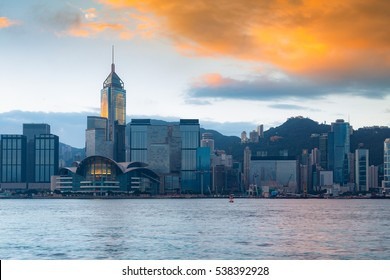 Hong Kong city with sunrise sky background over Victoria bay