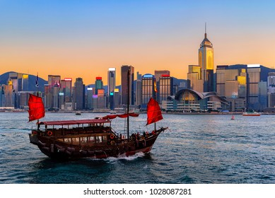 Hong Kong cityscape and barque in the evening over Victoria Harbour