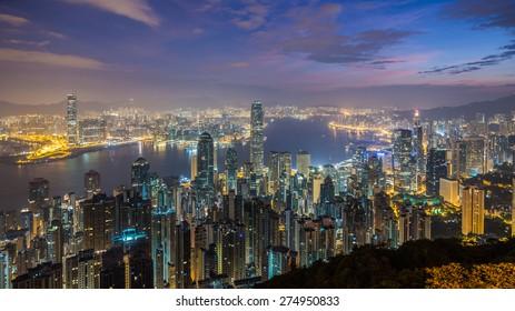 Hong Kong cityscape at dawn.