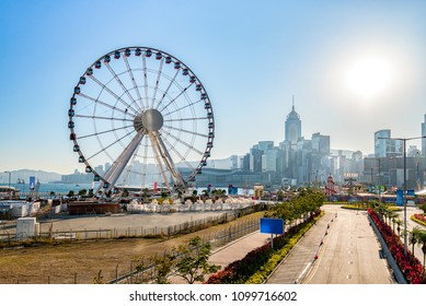 Hong Kong cityscape in the morning and Observation Wheel near Ferry Pier arera with landmark buildings in background.