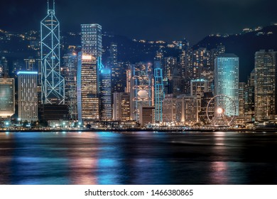 Hong Kong cityscape at night. View From Victoria Harbour