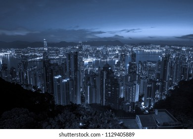 Hong Kong cityscape skyline in blue tone as viewed atop Victoria Peak