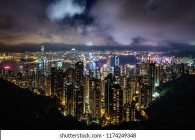 Hong Kong cityscape and Victoria Harbor at night in Hong Kong, China.
