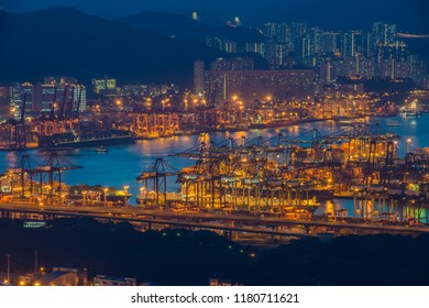 Hong Kong container terminal at dusk, container ship in import export and business logistics concept, shipping cargo to harbor, international transportation.