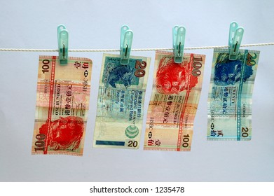 Hong Kong currency on a laundry line with blue background