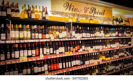 Hong Kong - DEC 11,2016: Wine shelves with price tags on display at store wine & spirit in Hong Kong, Defocused rows of Wine Liquor bottles on the supermarket shelf.