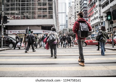 HONG KONG - Dec 2014: People walks across the street, Causeway Bay in Hong Kong. Hong Kong is one of the most densely populated areas in the world.