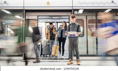 HONG KONG - Dec 2014: An unidentified traveler looks at a tourist map on subway MTR station in Hong Kong. Hong Kong subway is a convenient way to travel around the island.