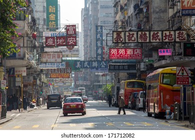 HONG KONG - DEC 22, 2013: Old fashioned streets in old district of Hong Kong in Mong Kok. With 7M population and land mass of 1104 sq km, it is one of the most dense areas in the world.
