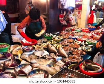 HONG KONG - DECEMBER 08, 2013: People shopping at fish market in Hong Kong