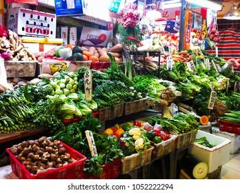 HONG KONG - DECEMBER 08, 2013: Vegetables and fruits at local market in Hong Kong
