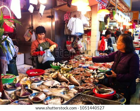 HONG KONG - DECEMBER 08, 2013: People shopping at fish market in Hong Kong