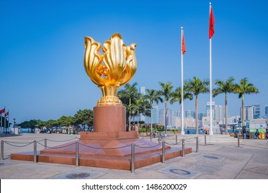 Hong Kong - December 15, 2016: Colden Bauhinia flower statue on Golden Bauhinia Square at sunny day time. Wan Chai district.