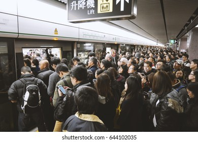 Hong Kong - December 16, 2013_Crowds of commuters and passengers at rush hour in subway station, Hong Kong, filter effect, film look