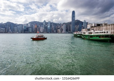 Hong Kong - December 4, 2018: Small boat on Kowloon Bay in with the HK Island city skyline in the background near the public ferry