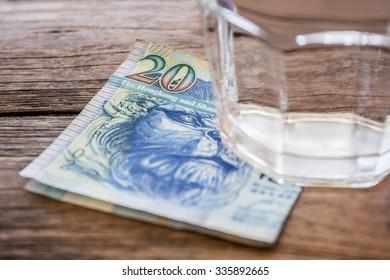 Hong Kong dollar bill under glass of water