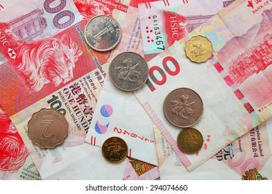 Hong Kong dollar money banknote with coins