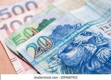Hong Kong dollars macro photo, colorful paper banknotes with selective focus