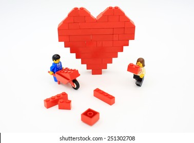 HONG KONG, FEB 14:  lego heart shaped love bricks which are isolated on white in hong kong on 14 february 2014. Lego minifigure are the successful line in Lego products