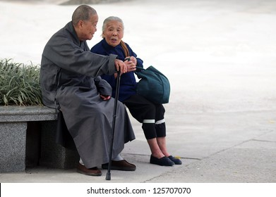 HONG KONG - FEB 21:Two old people talk at the park on February 21 2009 in Hong Kong, China.The population of the elderly in China is about 128 million and it's the largest in the world.