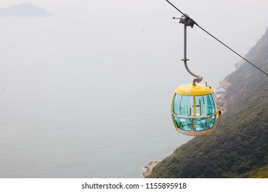 HONG KONG- FEBRUARY 10, 2018-A solitary cable car is seen over the edge of an island in Hong Kong Ocean Park, one of the largest amusement park in the country.