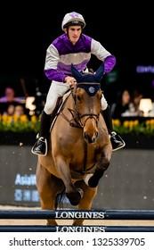 Hong Kong - February 12 2019: Rider Chad Schofield riding Rio competes during the Hong Kong Jockey Club Race of the Riders, Longines Master, at AsiaWorld Expo