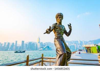 Hong Kong - February 9, 2015: Bruce Lee statue in Avenue of Stars. In the distance is Victoria Harbour. Located in the Avenue of Stars, Hong Kong.
