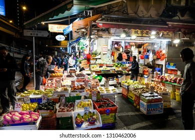 HONG KONG, February 9, 2019: Hong Kong street night market operates late into evening distributing various fruits and vegetables